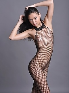 Sexy new model oiled up as well as in full body fishnet attire.