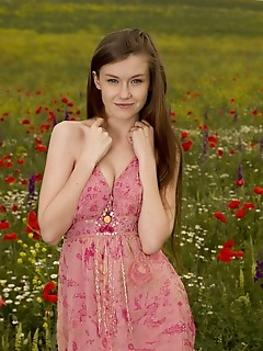 "Emily bloom ""emily blooms charming smile and nubile body stands out in a field of flowers"""