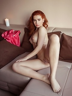 Nicole la cray redhead nicole la cray bares her sweet ass and delectable pussy on the couch.