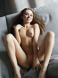 Linda chase linda chase strips on the couch baring her small tits and smooth pussy.