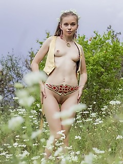 Milena d milena d bares her petite body as she sensually poses in the meadows.