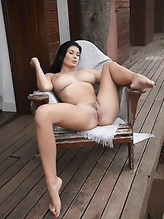 Lucy li lucy li erotically poses on the veranda baring her curvy body with meaty ass and large tits.