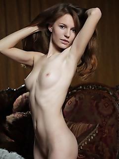 Sofi shane sofi shane strips her furry top baring her slender body and pink pussy.