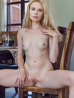 Maria rubio alluring blonde maria rubio bares her lusty body as she strips at the table.