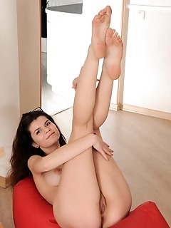 Davina newcomer davina flaunts her firm butt and small pussy on the floor.