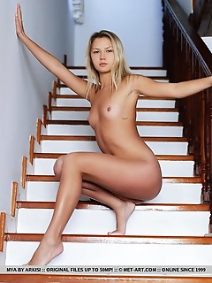 Mya mya displays her sweet pussy as she strips at the stairs.