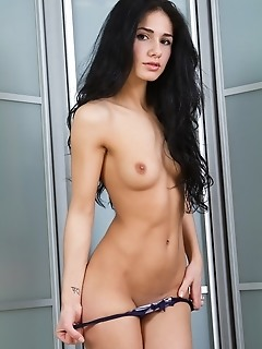 Dark-haired beauty with exotic charms and uninhibited appeal.