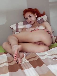 Ambre redhead amber strips off her jeans as she bares her nubile body on the bed.
