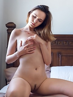 Nasita nasita displays her luscious body as she strips on the bed.