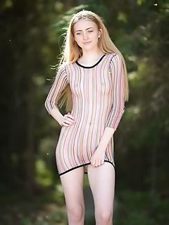 Lena flora lena flora bares her petite, creamy body as she strips outdoors.
