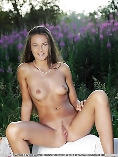 Slender, tanned model with vivacious smile and scrumptious assets showcased in the outdoors.