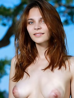 Olga rich olga rich strips by the beach as she displays her creamy body with puffy tits.