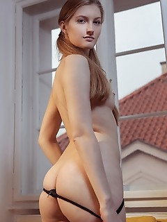 Bretona bretona strips on the couch baring her flexible, sexy body.
