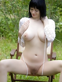 Sensual outdoor shoot with softcore appeal and ravishing energy.
