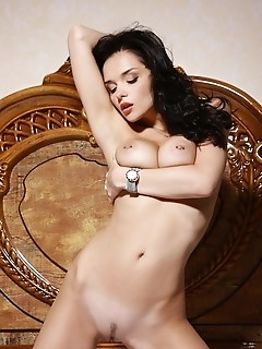 Busty bombshell with curvy body, pornstar appeal and super-vixen poses.
