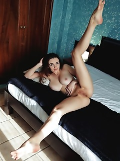 Maible maible bares her big naturals as she strips her black lingerie on the bed.