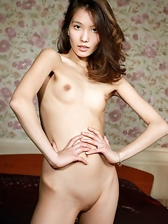 Anna aki new model anna aki displays her petite body and small pussy on the bed.
