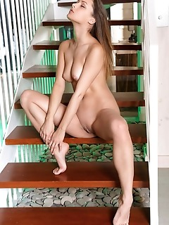 Yarina a yarina a sensually strips her sexy lingerie on the stairs.