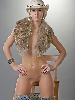 Ultra confident and seductive blonde in cowgirl ensemble.