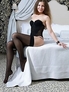 Vivian blue-eyed cutie vivian posing in a black bustier with matching string panty and knee-high stockings