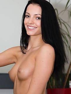 Sapphira a sapphira a sensually strips baring her sexy, tight body on the floor.
