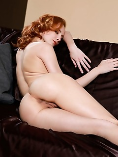 Kitty nice redhead kitty nice displays her amazing physique on the couch.