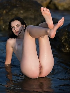 Cordoba ewcomer cordoba dips in the beach baring her sexy, wet body and tight ass.