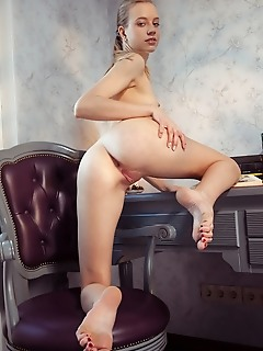 Kimberly kace kimberly kace displays her slender body, long legs and pink pussy on the chair.