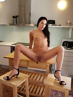 Eveline eveline flaunts her small tits and sweet pussy as she poses by the kitchen.