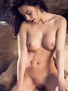 Nici dee against the picturesque beach background, nici dee showcases her perfectly sculpted body starting with her round, cuppable breasts, slim wais