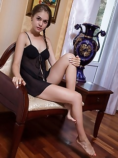 Maria espen maria espen flaunts her tight ass and small pussy on the chair.