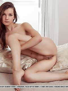 Iva iva bares her slender body with small tits and tight ass as she sensually poses by the window.