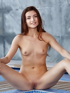 Berenice top model berenice dips her smoking hot body and delectable   pussy in the pool.