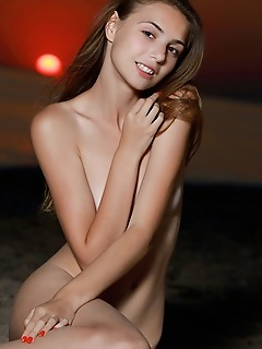 """Elle tan """"elle tans slender body and sensual curves stands out against a spectacular sunset by the beach"""""""