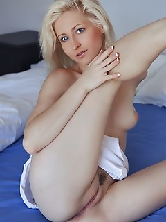 Janelle b blonde janelle b displays her sexy body with   gorgeous breasts and juicy pussy on the bed.