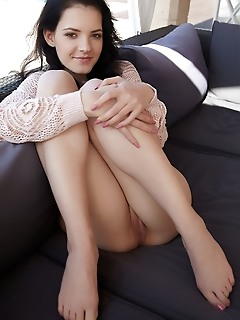 Anie darling top model anie darling displays her delectable body on the couch.