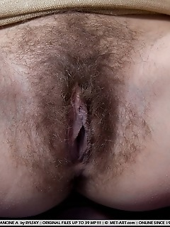 Nubile model with petite body and untrimmed bush.