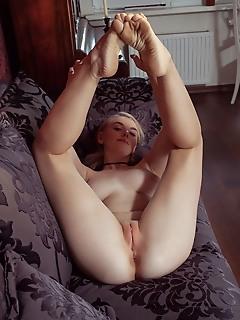 Daniel sea daniel sea shows off her curvy body and sweet tits on the sofa.