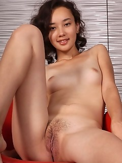 Djessy diessy shows off her nubile body and unshaven   pussy as she poses on the chair.