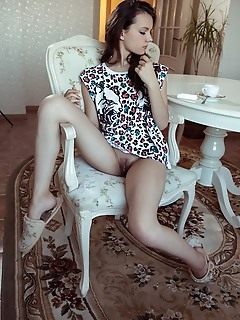 Iva iva bares her petite body and delectable pussy on the chair.