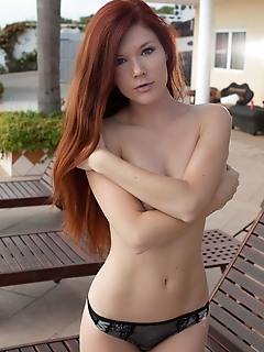 Mia sollis mia sollis gets cozy by the pool side, posing in her black lace pantys, shamelessly baring her delightfully erotic body.