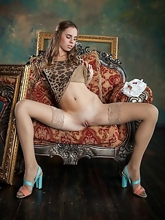 Gracie gracie sensually strips on the couch as she shows off her sweet pussy.