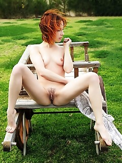 Night a redhead night a strips outdoors baring her delectable body.