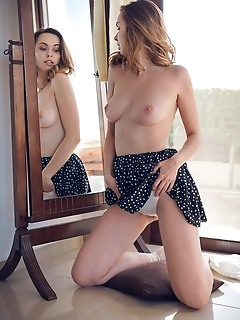Nasita nasita shows off her luscious body as she poses by the mirror.