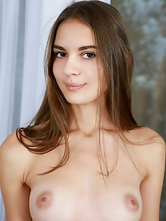 Valencia valencia bares her slender body, sweet ass and smooth pussy in front of the camera.