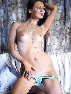 Yarina a seductive yarina a strips on the chair baring her delectable body.