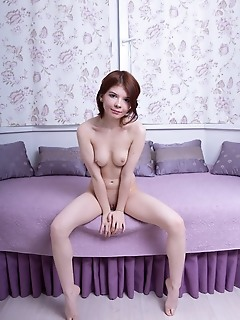 Renzi renzi strips her flowery dress as she displays her creamy body on the purple couch.